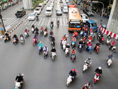 BANGKOK - NOV 17: Motorcyclists and cars wait at a junction during rush hour on Nov 17, 2012 in Bangkok, Thailand. Motorcycles are often the transport of choice for Bangkok's heavily congested roads. — Stock Photo
