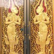 Pattern in traditional Thai style art painting on door of the temple  — Stock Photo #49478855