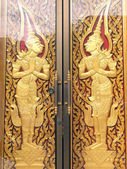 Pattern in traditional Thai style art painting on door of the temple  — Photo