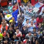 BANGKOK - APRIL 13: Crowd of people celebrating the traditional Songkran New Year Festival, April 13, 2012, Silom road, Bangkok, Thailand — Stock Photo #49497957