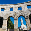 White Church Framed in the Arch of Ancient Roman Amphitheater in - ストック写真