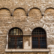 Arched Windows in Ancient House in Pula, Croatia - ストック写真