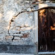 Arched Door in Old Weathered House in Pula, Croatia - ストック写真