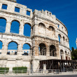 White Church and the Ancient Roman Amphitheater in Pula, Istria, — Stock Photo #12320933