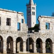 Stock Photo: White Church and Ancient RomAmphitheater in Pula, Istria,