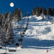 Full Moon above Riding Chairlift in French Alps Mountains, Megev - Stock Photo