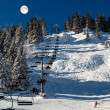 Full Moon above Riding Chairlift in French Alps Mountains, Megev - Photo