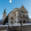Full Moon above Medieval Church on the Central Square of Megeve, — Stockfoto