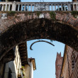 Stock Photo: Arch Between Piazza Erbe and Signori in Verona with Hanging Whal