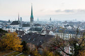 Aerial View on Tiled Roofs and Churches of Zurich at Fall, Switz — Stock Photo
