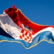 Croatian Flag Waving on a Pole over Beautiful Blue Sky in Omis, — Stock Photo #25167639