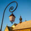 Street Lamp and Medieval Church in Megeve, French Alps — ストック写真