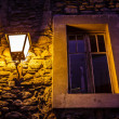 Stock Photo: Window Illuminated By Street Lamp in Megeve, French Alps