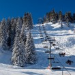 Stock Photo: Sunny Ski Slope and Ski Lift near Megeve in French Alps, France