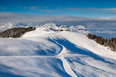Skiën en snowboarden in franse alpen, megeve — Stockfoto
