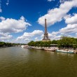 Eiffel Tower and Seine River with White Clouds in Background, Pa — Stock Photo #28162093