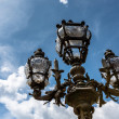 street lantern on the alexandre iii bridge against cloudy sky, p — Stock Photo