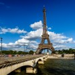 Eiffel Tower and Seine River with White Clouds in Background, Pa — Stock Photo #28939227