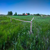Red House and Wooden Fence in Traditional Russian Village near M — Stock Photo