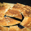 Pancakes on Griddle — Stock Photo