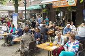 NETHERLANDS - VOORSCHOTEN - 15 JUNI 2014: People on a terrace of Cafe Weapon of Voorschoten, during Jazz Culinary. — Stock Photo