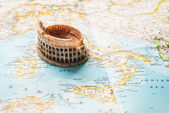 A miniature of Colosseum on a map — Stock Photo