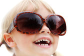 Close-up portrait of a cute little girl wearing oversized sunglasses. — Stock Photo