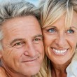 Happy mature couple outdoors — Stock Photo #24390307