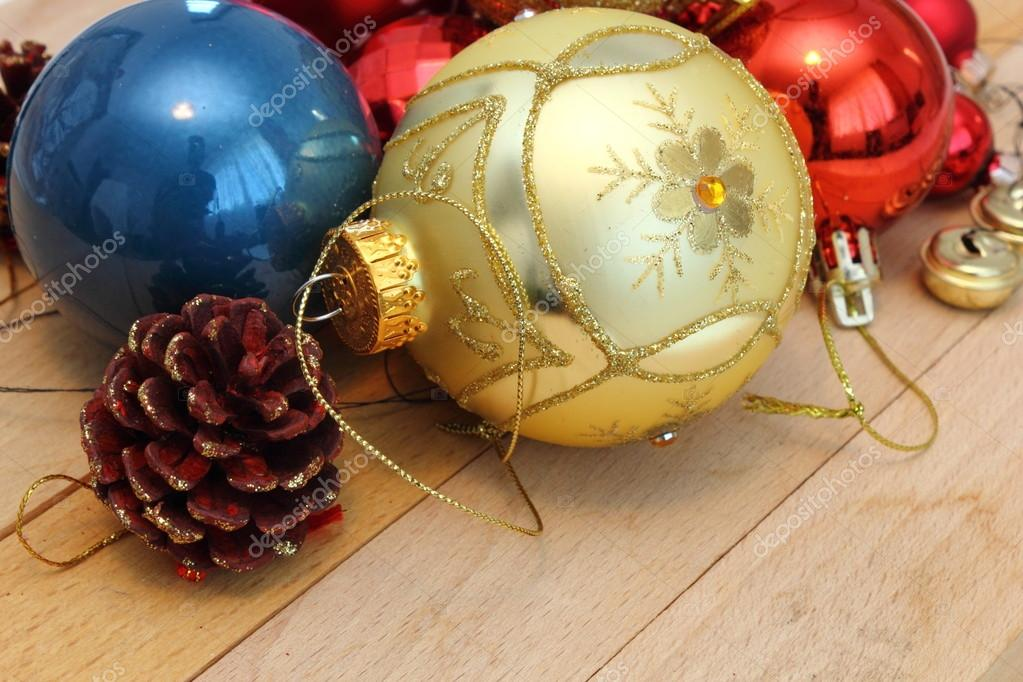 Christmas decoration over wood ready for christmas tree — Stock Photo #14155449
