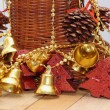 Gold bells and christmas tree shaped candles — Stock Photo