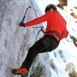 Man climbing on ice — Stock Photo