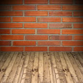 Old brick wall and wooden floor — Stock Photo