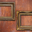 Two vintage frames on rusty metal wall — Stock Photo