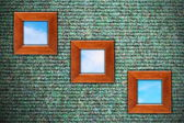 Grungy wall with three wooden frames — Stock Photo