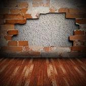 Pared agrietada y piso de madera — Foto de Stock
