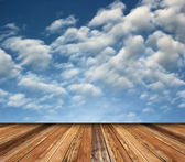 Beautiful sky backdrop and wooden floor — 图库照片