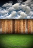 Natural backdrop wooden fence and grass — Stock Photo