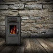 图库照片: Grunge interior backdrop with burning stove