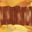 Wooden background with cherry leaves — Stock Photo
