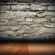 Stock Photo: Weathered stone wall and wood floor