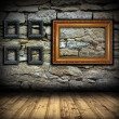 Stone wall with wood painting frames — Stock Photo