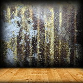 Corroded metal wall and wood floor — Stock Photo