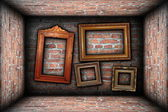 Vintage room interior backdrop with ancient frames — Stock Photo