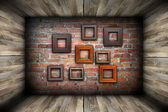 Empty room with frames on wall — Stock Photo