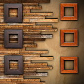 Frames on wooden finished wall — Stok fotoğraf