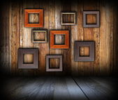 Wooden interior background with frames — Stock Photo