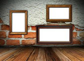 Cracked wall with frames — Stockfoto