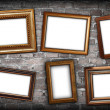 Messy arrangement of frames on wall — Stock Photo