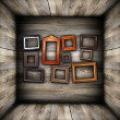 Collection of beautiful frames on wood wall — Stock Photo