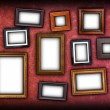 Red scratched wall with frames — Stock Photo